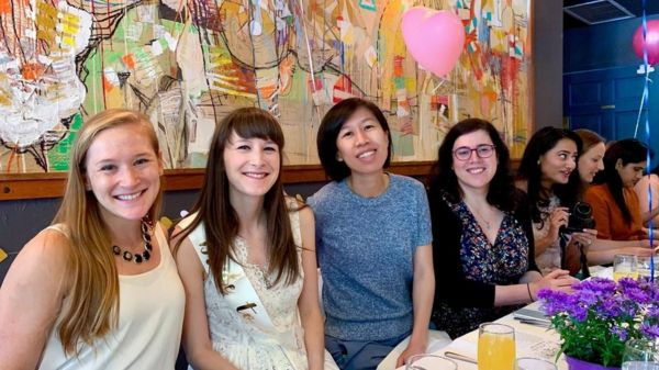 Kimberly Ha in a restaurant with friends