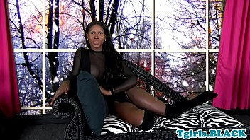 Gorgeous ebony shemale tugging her black cock