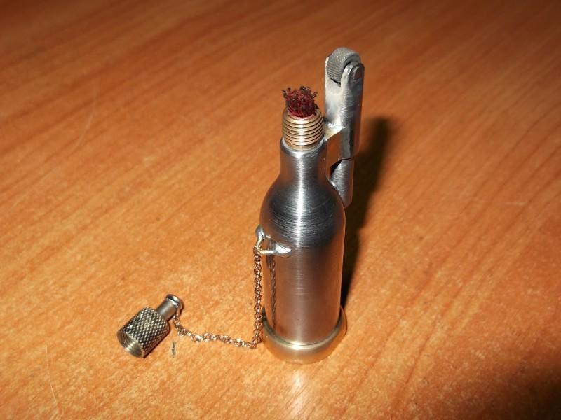 Изображение - Ремонт бензиновых зажигалок своими руками proxy?url=http%3A%2F%2Fmozgochiny.ru%2Fwp-content%2Fuploads98983jkhdkjf9873%2F2013%2F04%2FBenzinovaya-zazhigalka-004-800x600